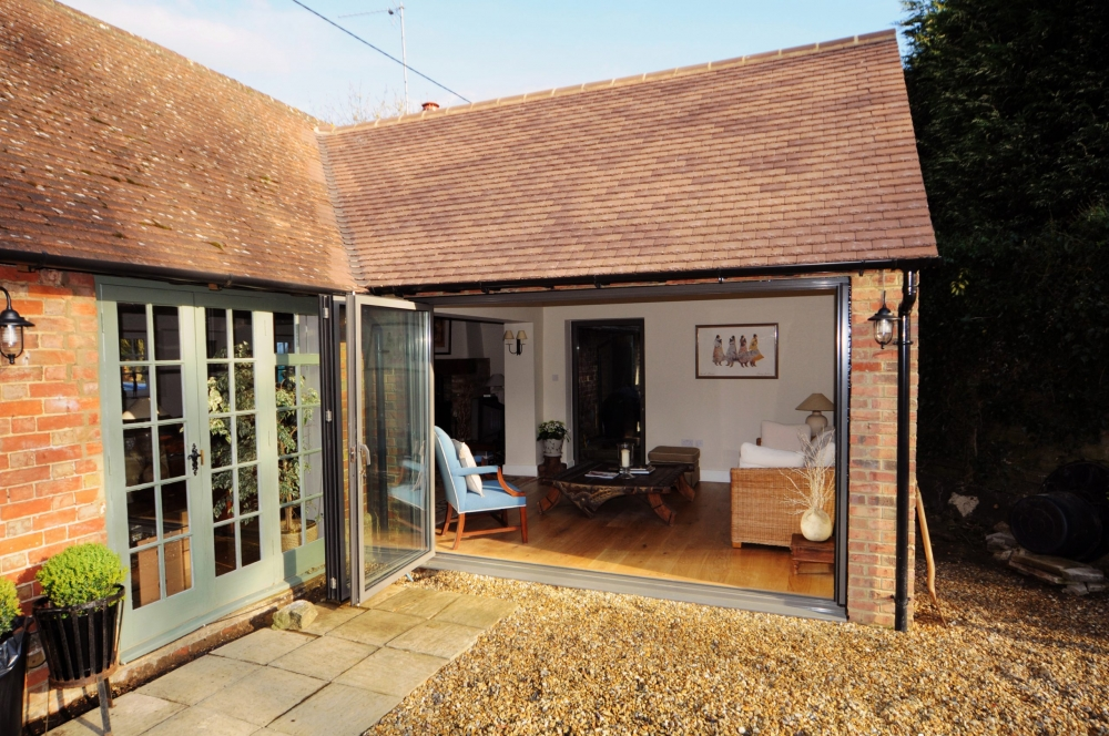 stables cottage bifolding doors open